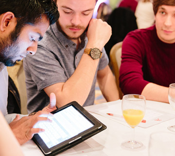 User on their iPad at a company conference